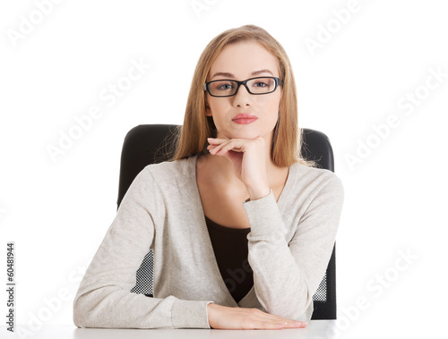 Portrait of beautiful attractive woman in eyeglasses. She's sitt