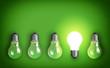 Leinwanddruck Bild - Idea concept with row of light bulbs and glowing bulb