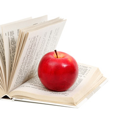 red apple on a book isolated on white background