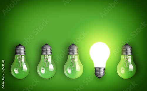 Leinwanddruck Bild Idea concept with row of light bulbs and glowing bulb