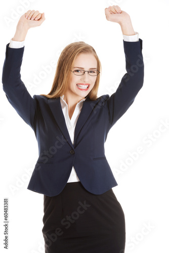 Beautiful business woman with her hands up. She's satisfied.