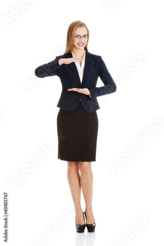 Beautiful business woman holding empty copy space between her ha