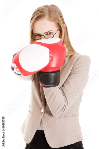 Beautiful caucasian woman with boxing gloves.