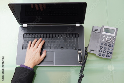 businessman talking on the phone and working on the laptop in th