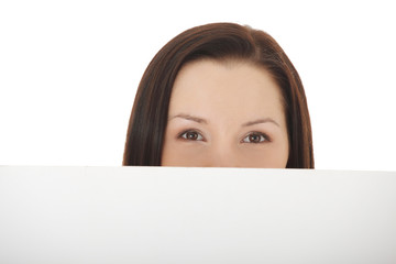 Beautiful woman's face behind copy space.