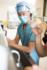 Surgeon Scrubing Arms and Hands