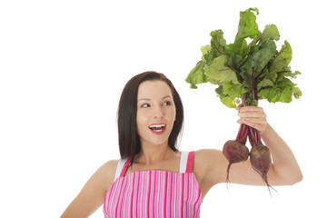 Young woman in apron and holding beetroots.