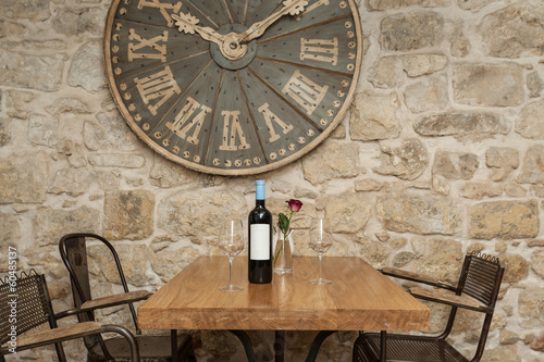 Wine bottle and two glasses on the wooden table