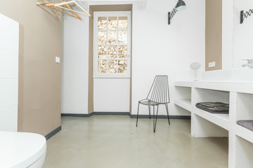 Big comfortable toilet room with chair