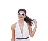 Attractive woman wearing sunglasses against white