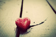 Red heart in crack of wooden plank. Symbol of love. Vintage