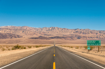 Death Valley, California - Empty infinite Road in the Desert