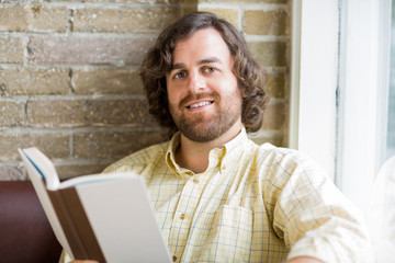 Man With Book In Coffeeshop