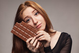 Portrait of sad young girl with the big chocolate