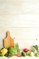 Spring vegetables with cutting board