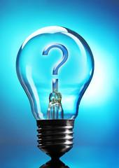 Question mark in lightbulb on blue background