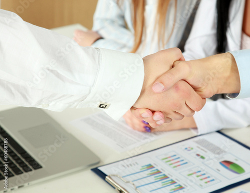 business colleagues shaking hands,