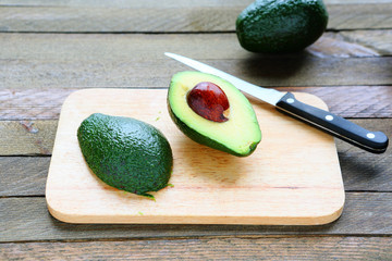 sliced ​​avocado on a blackboard