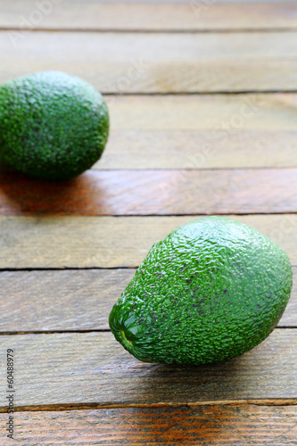 whole avocado on wooden surface