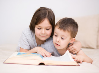 Children is reading book