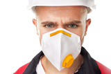 Serious worker wearing respirator