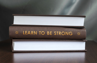 Learn to be strong. Book concept.