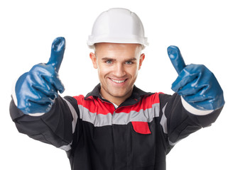 Worker in protective gloves giving thumb up