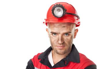 Portrait of serious coal miner