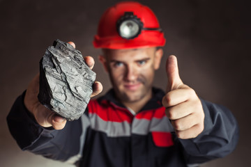 Coal miner with lump of coal