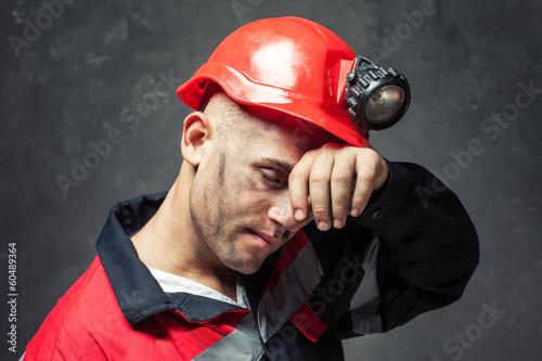 Portrait of tired coal miner - 60489364