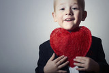 Smiling Child with Red Heart.Funny Boy in Black Suit.Symbol