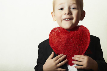 Smiling Child with Red Heart.Valentine's Day for Mother