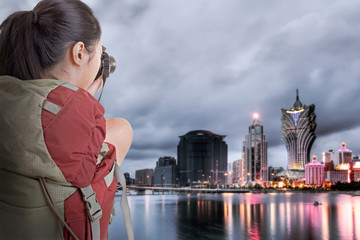 Young backpacker travel and take picture