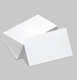 Stack of blank business card with one card in front on white bac