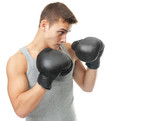 muscular young boxer man ready to fight