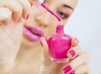 manicure process - beautiful girl makes pink manicure