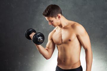 Bodybuilder man exercising with dumbbell