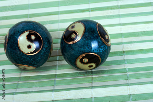 Chinese balls for relaxation on bamboo background