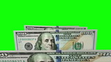 New one hundred dollars bills in carousel. Loop on greenscreen