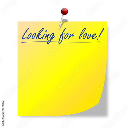 Yellow paper with the inscription looking for love - vector