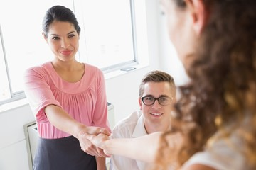 Businesswoman shaking hands with female partner