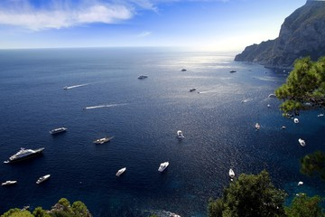 Yachts anchored in the north coast of Capri island