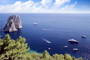 Yachts anchored in Il Faraglioni in Capri island