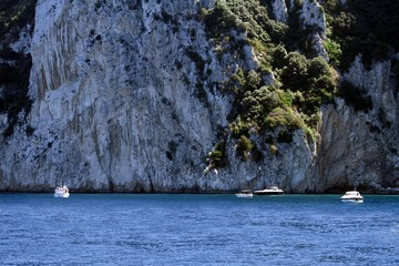 Boats anchored in the cliffs of Capri island