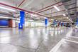 Leinwanddruck Bild - Parking garage, underground interior with a few parked cars