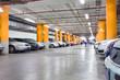 Parking garage, underground interior with a few parked cars