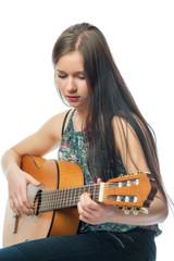 Mädchen spielt Gitarre