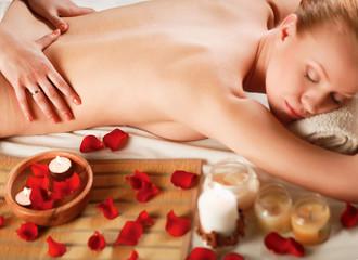 Beautiful young woman getting spa massage.