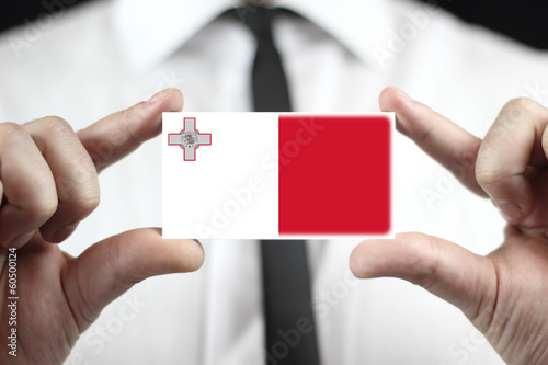 Businessman holding a business card with Malta Flag