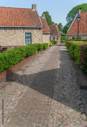 Old street in the restored village of Boertange in Groningen